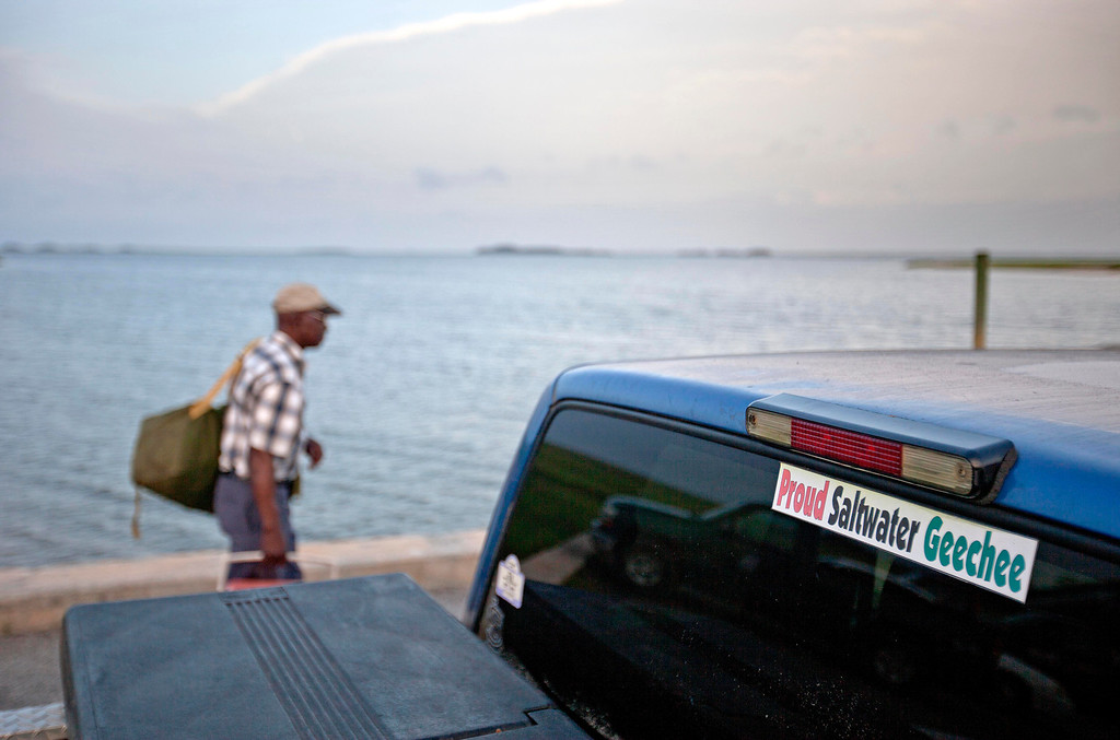 . A sticker celebrating the Geechee heritage is seen on a pickup truck as passengers board a ferry to the mainland on Sapelo Island, Ga. on Sunday, June 9, 2013. (AP Photo/David Goldman)