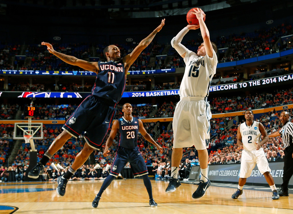 . Villanova\'s Ryan Arcidiacono (15) shoots over Connecticut\'s Ryan Boatright (11) during the first half of a third-round game in the NCAA men\'s college basketball tournament in Buffalo, N.Y., Saturday, March 22, 2014. (AP Photo/Bill Wippert)