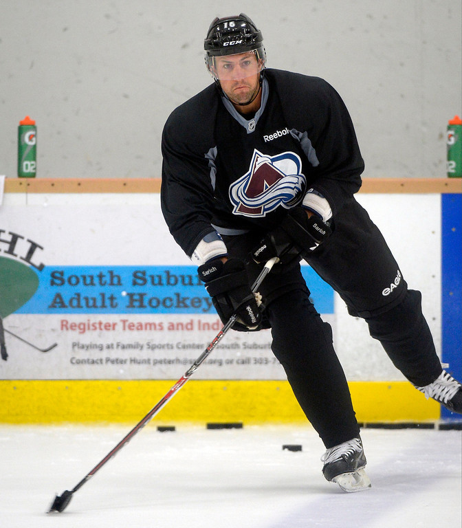 . Colorado Avalanche D Cory Sarich (16) controls the puck during practice September 10, 2013 at Family Sports.  (Photo By John Leyba/The Denver Post)