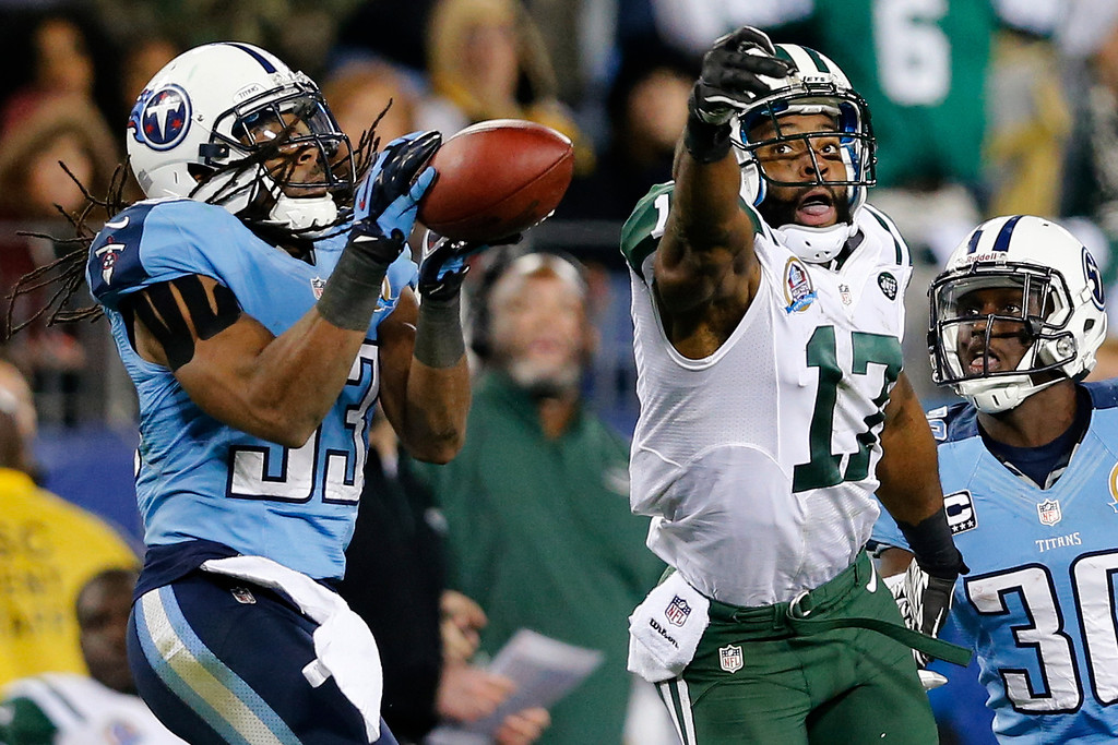 . Tennessee Titans safety Michael Griffin (33) intercepts a pass intended for New York Jets wide receiver Braylon Edwards (17) in the fourth quarter of an NFL football game, Monday, Dec. 17, 2012, in Nashville, Tenn. The Titans won 14-10. At right is Titans cornerback Jason McCourty (30). (AP Photo/Joe Howell)