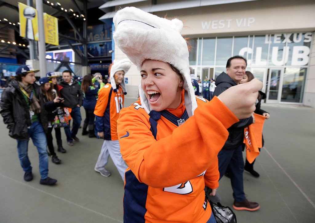 . Denver Broncos fan Leinani Cagulada from Tustin, Calif., cheers before the NFL Super Bowl XLVIII football game between the Seattle Seahawks and the Denver Broncos, Sunday, Feb. 2, 2014, in East Rutherford, N.J. (AP Photo/Ted S. Warren)