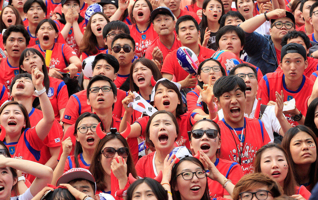 . South Korean soccer fans react after Russian soccer team scored a goal against South Korea during  the group H World Cup soccer match between Russia and South Korea, at a public viewing venue in Seoul, South Korea, Wednesday, June 18, 2014. (AP Photo/Ahn Young-joon)