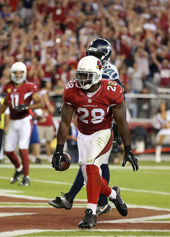 . GLENDALE, AZ - OCTOBER 17:  Running back Rashard Mendenhall #28 of the Arizona Cardinals scores a touchdown in the second quarter against the Seattle Seahawks during a game at the University of Phoenix Stadium on October 17, 2013 in Glendale, Arizona.  (Photo by Christian Petersen/Getty Images)