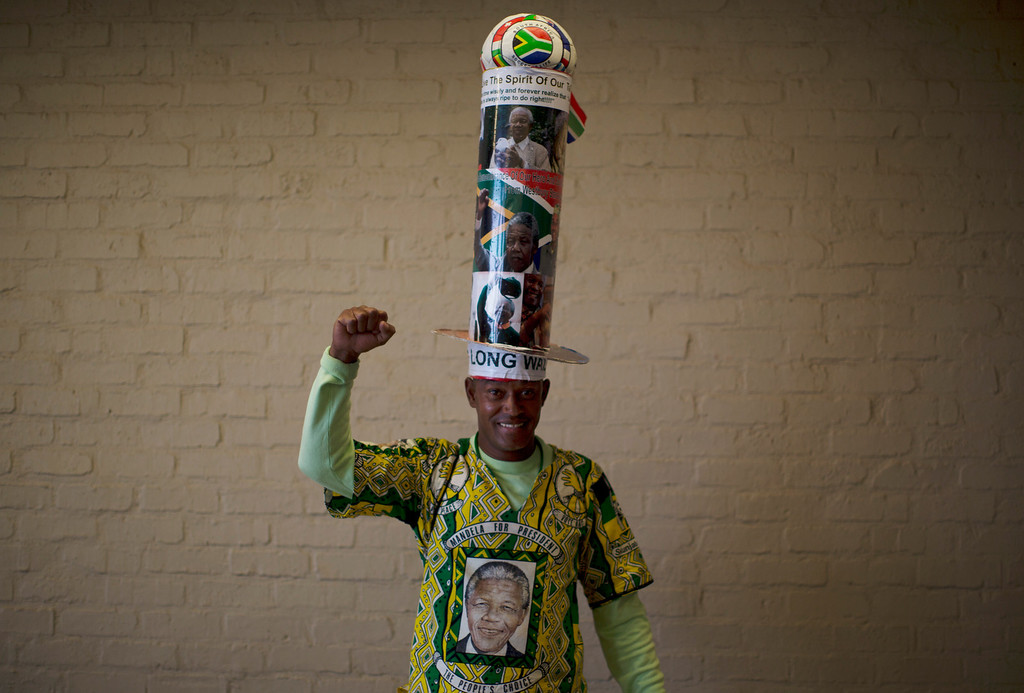 . A mourner poses with his homemade hat before the memorial service for former South African president Nelson Mandela at the FNB Stadium in Soweto near Johannesburg, Tuesday, Dec. 10, 2013. (AP Photo/Muhammed Muheisen)
