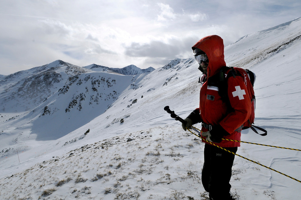 """. A Breckenridge Ski Patrol member sets ropes to mark a boundary on the new Peak 6 expansion scheduled to open at noon on Wednesday. Looking south toward Peak 7 on the left, the new terrain includes \""""Serenity Bowl\"""" and the extreme terrain of \""""The Six Senses.\"""" Scott Willoughby, The Denver Post"""