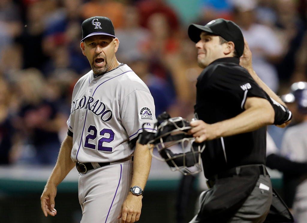 . Colorado Rockies manager Walt Weiss (22) yells at home plate umpire John Tumpane as he is ejected in the sixth inning of a baseball game against the Cleveland Indians on Friday, May 30, 2014, in Cleveland. Weiss argued with Trumpane after Michael Cuddyer was called out on strikes. (AP Photo/Mark Duncan)