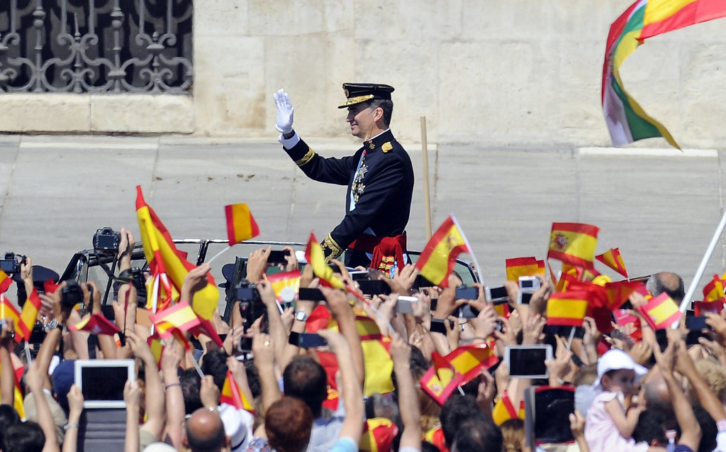 . Spain\'s King Felipe VI waves on arrival to the Palacio de Oriente or Royal Palace in Madrid on June 19, 2014 following a swearing in ceremony of Spain\'s new King before both houses of parliament.   AFP PHOTO / MIGUEL  RIOPA/AFP/Getty Images