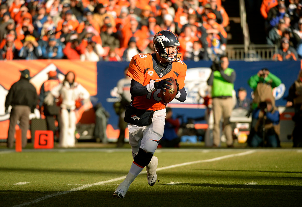 . Denver Broncos quarterback Peyton Manning (18) drops back to throw during the first quarter. The Denver Broncos vs. The San Diego Chargers in an AFC Divisional Playoff game at Sports Authority Field at Mile High in Denver on January 12, 2014. (Photo by John Leyba/The Denver Post)