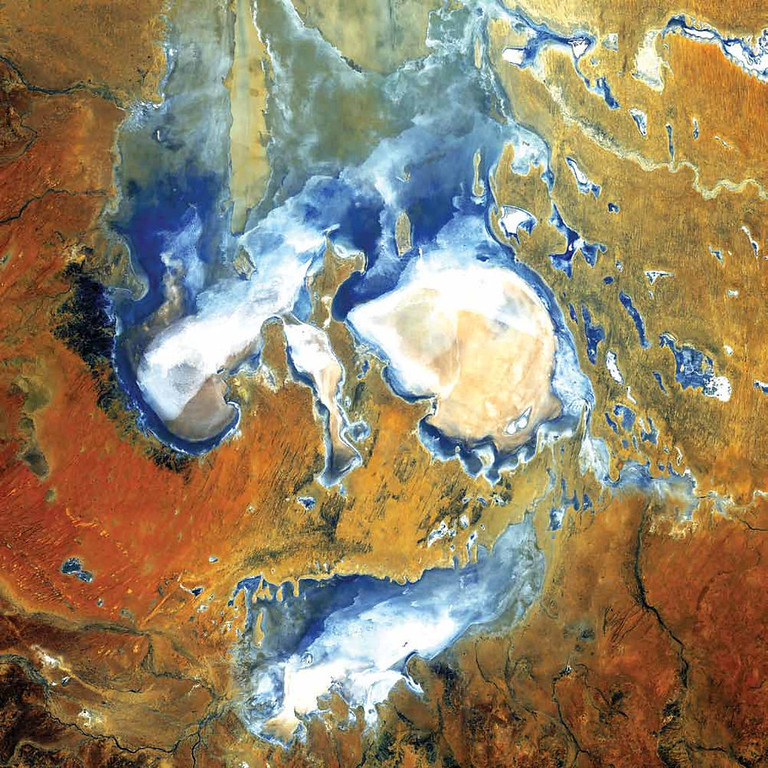 . Lake Eyre, Australia Deep in the desert country of northern South Australia, Lake Eyre is an ephemeral feature of this flat landscape. Lake Eyre is home to some rare ecosystems and is the largest salt pan in the world. It spans 9,300 square kilometers and sits 15 meters below sea level. The lake�s basin sprawls across 1.2 million square kilometers, stretching from the Northern Territory to South Australia. Rain, when it falls, drains through the basin into Lake Eyre, which has no outlet. The lake has rarely filled completely, with spectacular fillings occurring in 1950, 1974, and 1984. When brimming, Lake Eyre is Australia�s largest lake. Landsat 5 collected this image in 2006.   NASA