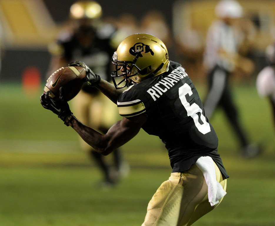 . BOULDER, CO. - SEPTEMBER 76: Buffs wide receiver Paul Richardson (6) gathered in a Connor Wood pass for a touchdown in the fourth quarter.  The Buffs took a lead on the TD 31-24. The University of Colorado football team hosted Central Arkansas at Folsom Field Saturday night, September 7, 2013. Photo By Karl Gehring/The Denver Post