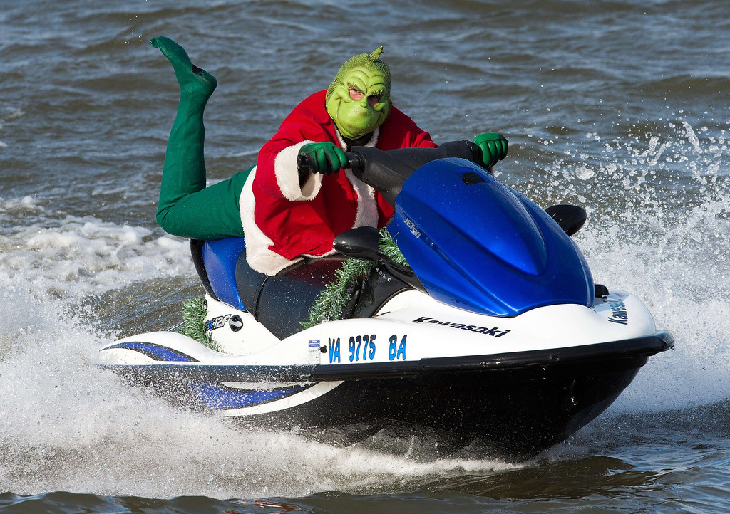 . A Grinch on a jet ski is seen on the Potomac River on December 24, 2013 at National Harbor, Maryland, near Washington. The group of volunteers are celebrating their 28th anniversary of the event that also has a skiing Santa, kneeboarding reindeer, flying elves, and Frosty the snowman.    PAUL J. RICHARDS/AFP/Getty Images