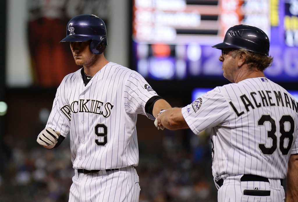 . DENVER, CO. - June 28: DJ LeMahieu of Colorado Rockies (9) celebrate his base hit with first base coach Rene Lachemann (38) in the 1st inning of the game against San Francisco Giants at Coors Field. Denver, Colorado. June 28, 2013. (Photo By Hyoung Chang/The Denver Post)