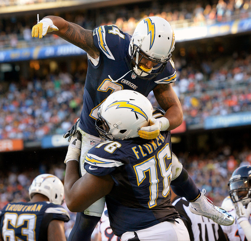. Running back Ryan Mathews #24 of the San Diego Chargers celebrates his touchdown with offensive tackle D.J. Fluker #76 in the 4th quarter at Qualcomm Stadium November 10, 2013 San Diego, CA. (Photo By Joe Amon/The Denver Post)