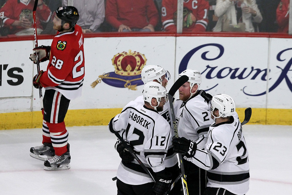 . Jeff Carter #77 of the Los Angeles Kings celebrates with his teammates after scoring a goal against Corey Crawford #50 of the Chicago Blackhawks in the first period during Game Seven of the Western Conference Final in the 2014 Stanley Cup Playoffs at United Center on June 1, 2014 in Chicago, Illinois.  (Photo by Tasos Katopodis/Getty Images)
