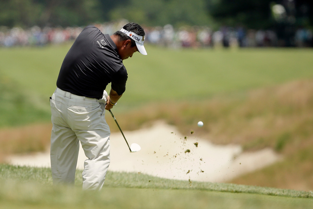 . K.J. Choi, of South Korea, tees off on the fourth hole during the third round of the U.S. Open golf tournament at Merion Golf Club, Saturday, June 15, 2013, in Ardmore, Pa. (AP Photo/Charlie Riedel)