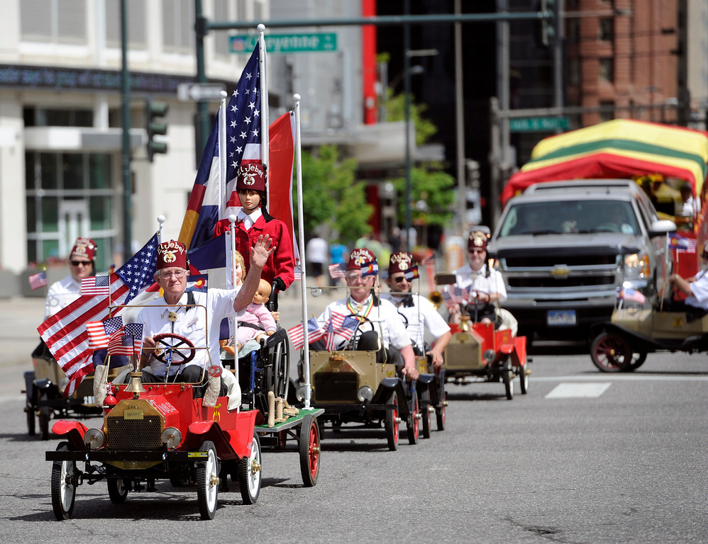 . Members of the El Jebel make their way down Broadway.  (Photo By Kathryn Scott Osler/The Denver Post)