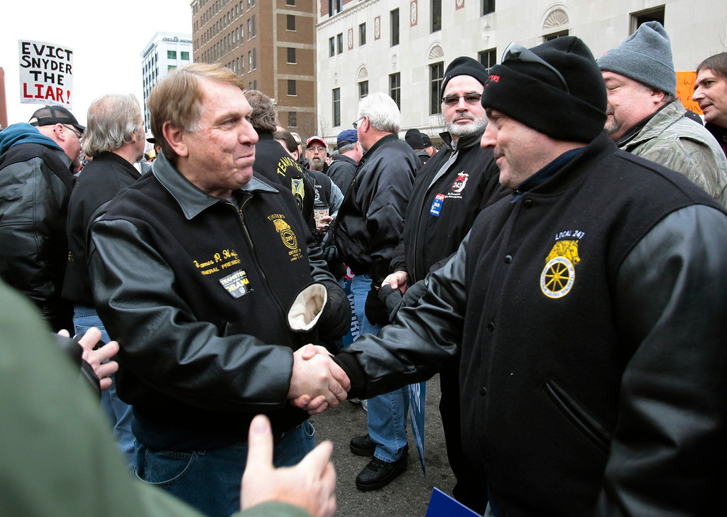 ". James P. Hoffa (L), the General President of the Teamsters Union, greets anti right-to-work protesters outside of Michigan\'s state capitol building in Lansing December 11, 2012. The Republican-majority Michigan legislature gave final approval on Tuesday to ""right-to-work\"" restrictions on public sector unions in a state considered a stronghold of organized labor, as protesters chanted in the gallery and thousands rallied outside.      REUTERS/Rebecca Cook"