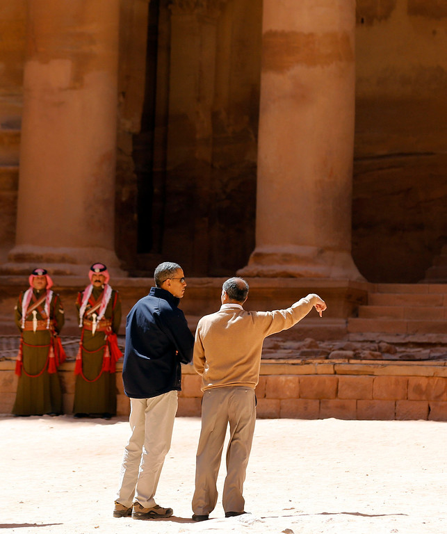 . U.S. President Barack Obama (L) stops to look at the Treasury while he receives a tour of the ancient historic and archaeological site of Petra March 23, 2013. Obama visited Jordan\'s ancient city of Petra on Saturday as he wrapped up a four-day Middle East tour by setting aside weighty diplomatic matters and playing tourist for a day. REUTERS/Larry Downing