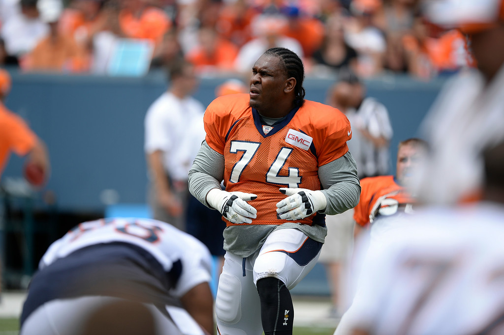 . Denver Broncos tackle Orlando Franklin (74) stretches on day four of the Denver Broncos 2014 training camp July 27, 2014 at Sports Authority Field at Mile High. (Photo by John Leyba/The Denver Post)