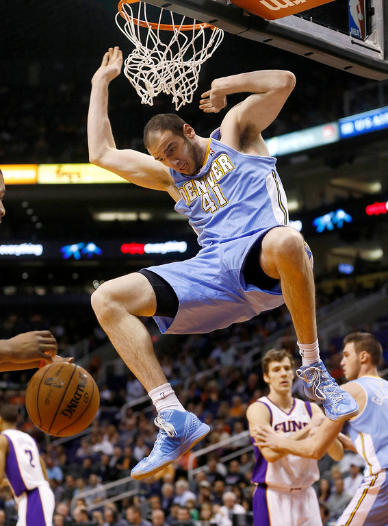 . Denver Nuggets\' Kosta Koufos (41) dunks against the Phoenix Suns during the first half of an NBA basketball game, Monday, March 11, 2013, in Phoenix. (AP Photo/Matt York)
