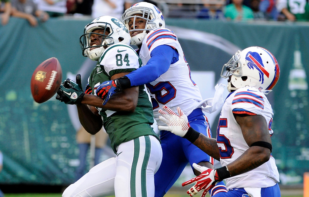 . Buffalo Bills defensive back Justin Rogers breaks up a pass to New York Jets\' Stephen Hill (84) during the first half of an NFL football game Sunday, Sept. 22, 2013, in East Rutherford, N.J. (AP Photo/Bill Kostroun)