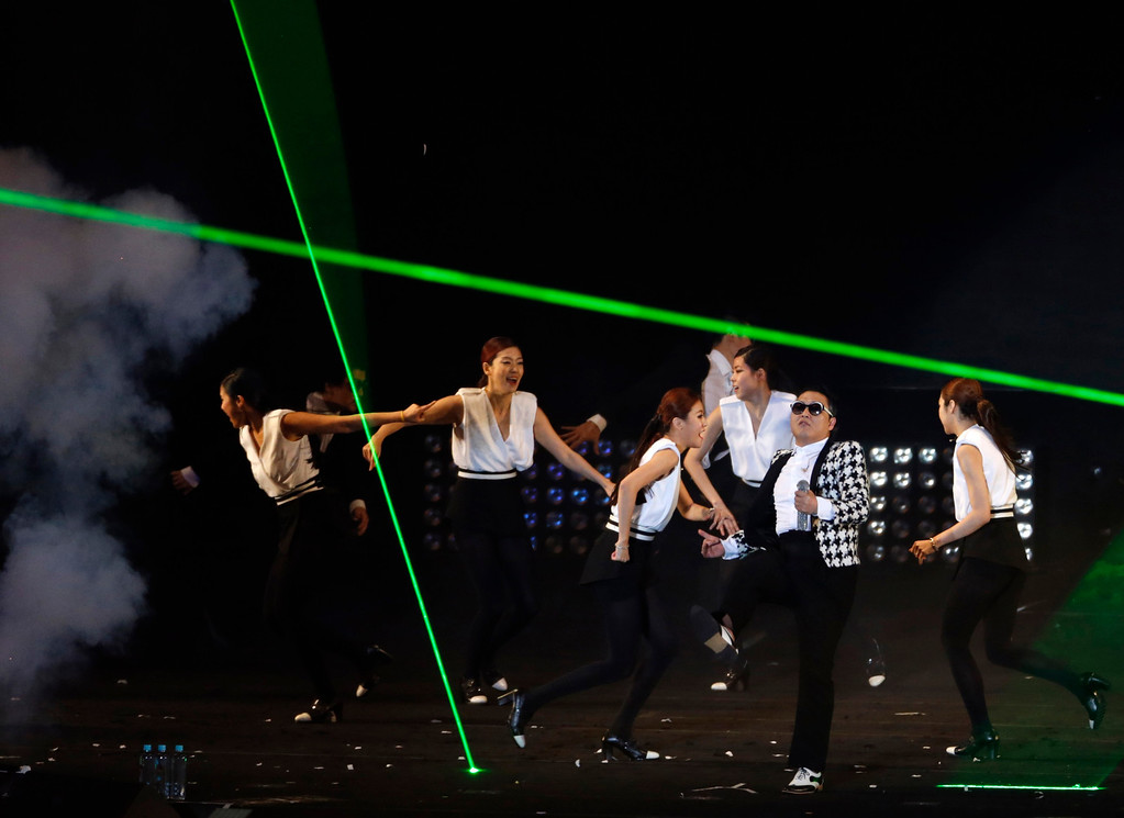 ". South Korean rapper Psy performs ""Gentleman\"" during his concert \""Happening\"" in Seoul April 13, 2013. Psy performed his new song \""Gentleman\"" in public for the first time on Saturday at a concert at Seoul\'s World Cup stadium. Psy released his new single on Thursday hoping to repeat the success of \""Gangnam Style\"" that made him the biggest star to emerge from the growing K-pop music scene.  REUTERS/Lee Jae-Won"
