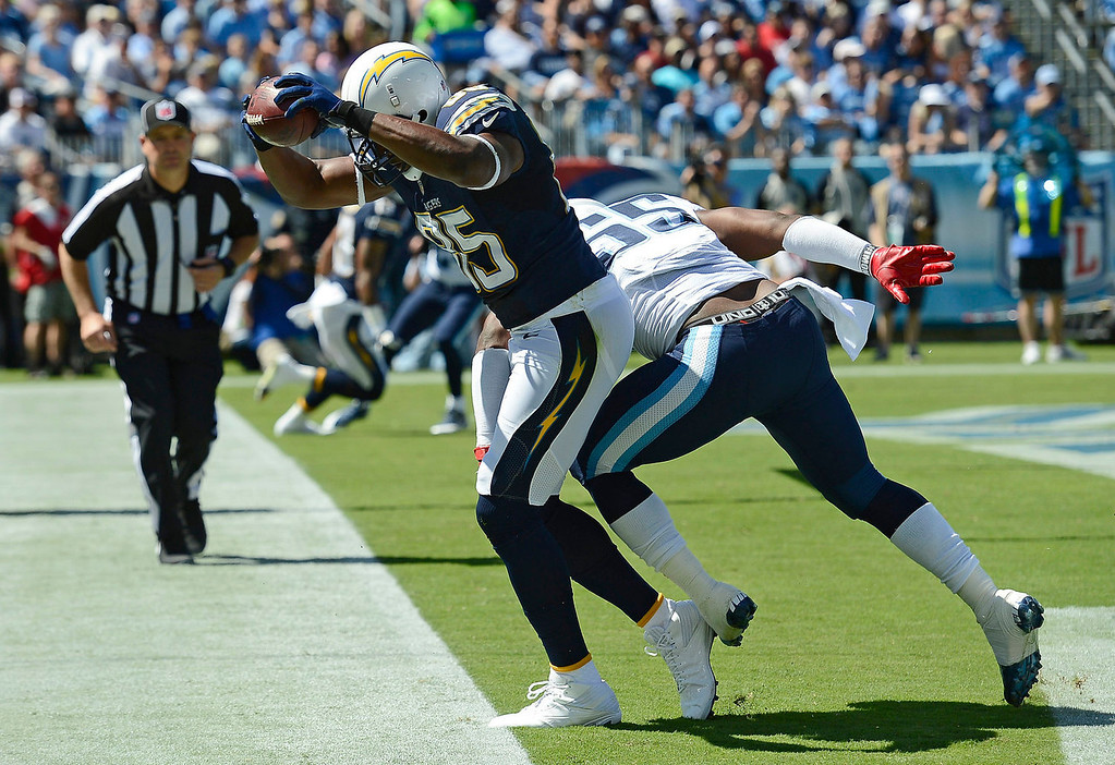 . San Diego Chargers tight end Antonio Gates (85) catches a 7-yard touchdown pass as he is defended by Tennessee Titans linebacker Zach Brown (55) in the first quarter of an NFL football game on Sunday, Sept. 22, 2013, in Nashville, Tenn. (AP Photo/Mark Zaleski)