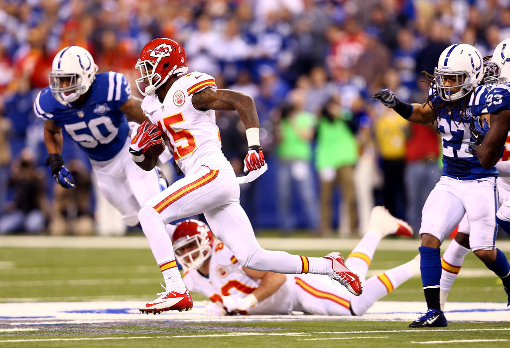 . INDIANAPOLIS, IN - JANUARY 04: Wide receiver A.J. Jenkins #15 of the Kansas City Chiefs runs with the ball against the Indianapolis Colts during a Wild Card Playoff game at Lucas Oil Stadium on January 4, 2014 in Indianapolis, Indiana.  (Photo by Andy Lyons/Getty Images)
