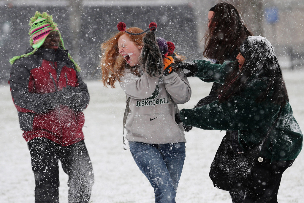 . Student tourists from Chattanooga, Tennessee, have a snowball fight on  National Mall January 21, 2014 in Washington, DC. A strong winter storm is bearing down on the East Coast between Virginia and Massachusetts and could dump four to eight inches of snow on the Washington area.  (Photo by Chip Somodevilla/Getty Images)