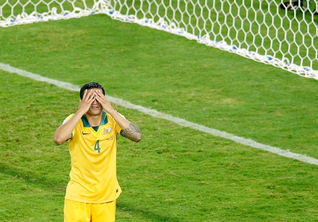 . Australia\'s Tim Cahill rects after missing a chance to score during the group B World Cup soccer match between Chile and Australia in the Arena Pantanal in Cuiaba, Brazil, Friday, June 13, 2014. (AP Photo/Michael Sohn)