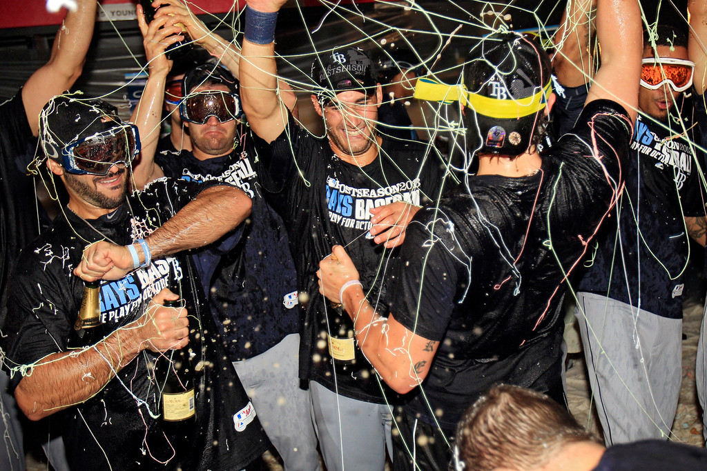 . Tampa Bay Rays players celebrate in the clubhouse after beating the Cleveland Indians 4-0 in the AL wild-card baseball game Wednesday, Oct. 2, 2013, in Cleveland. The Rays advance to the AL division series against the Boston Red Sox. (AP Photo/Tony Dejak)