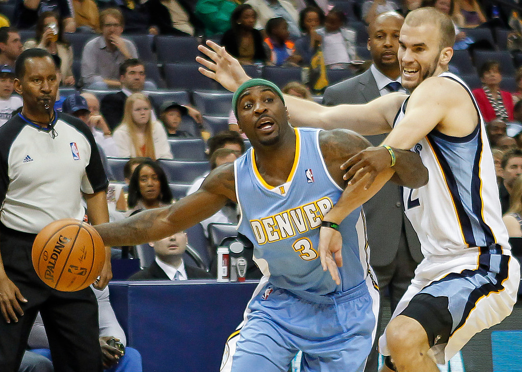 . Denver Nuggets guard Ty Lawson (3) tries to get around Memphis Grizzlies guard Nick Calathes in the first half of an NBA basketball game Friday, April 4, 2014, in Memphis, Tenn. (AP Photo/Lance Murphey)