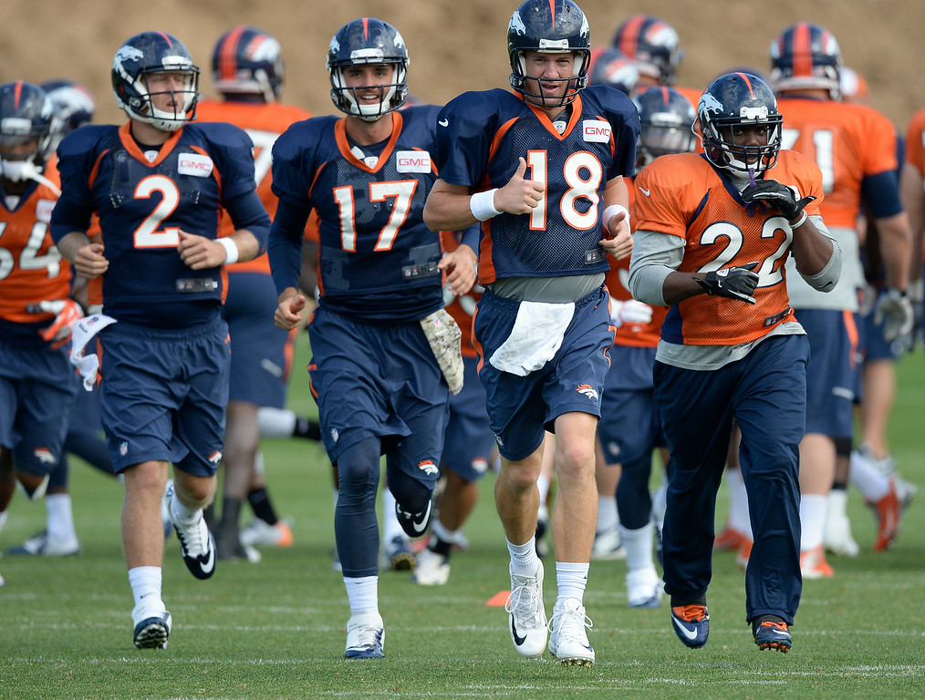 . Denver Broncos quarterback Peyton Manning (18) leads the way for drills on day 12 of the Denver Broncos 2014 training camp August 5, 2014 at Dove Valley. (Photo by John Leyba/The Denver Post)