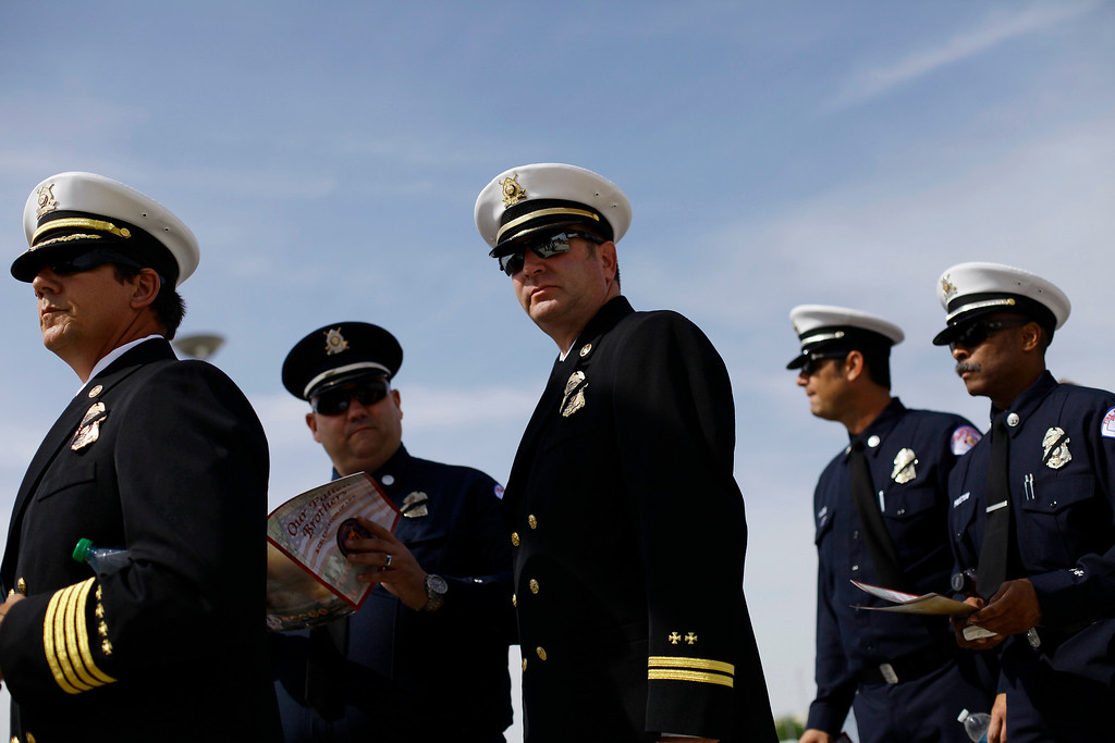 . Members of the Long Beach Fire Department from California attend a memorial for the Prescott Fire Department\'s Granite Mountain Interagency Hot Shot Crew in Prescott Valley, Arizona July 9, 2013. REUTERS/Joshua Lott