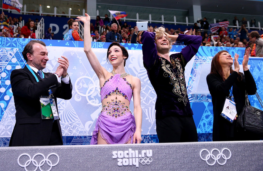 . Meryl Davis (2L) and Charlie White (2R) of the United States celebrate the gold medal with thier coaches Oleg Epstein (1L) and Marina Zoueva (1R) in the Figure Skating Ice Dance Free Dance on Day 10 of the Sochi 2014 Winter Olympics at Iceberg Skating Palace on February 17, 2014 in Sochi, Russia.  (Photo by Ryan Pierse/Getty Images)