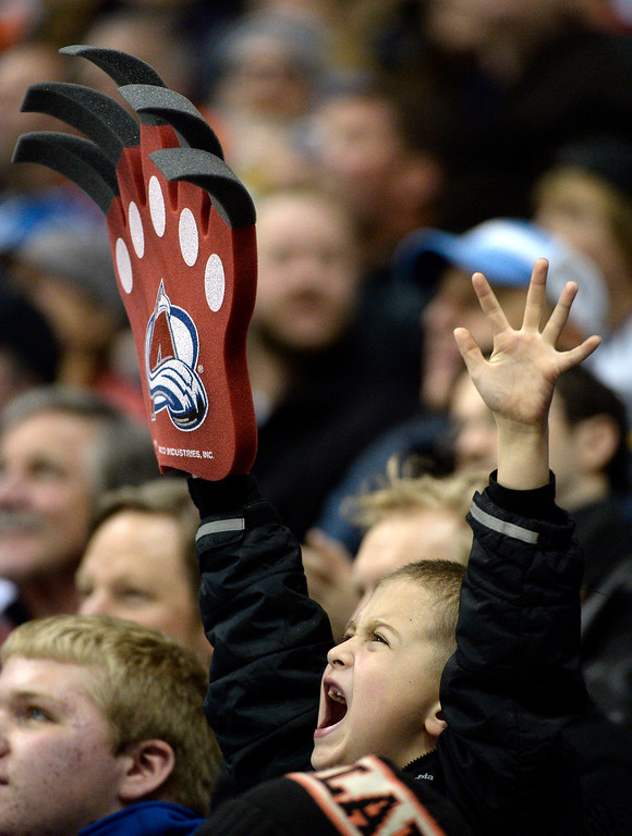 . A Colorado Avalanche  fan cheers during the third period against the Philadelphia Flyers January 2, 2014 at Pepsi Center. (Photo by John Leyba/The Denver Post)