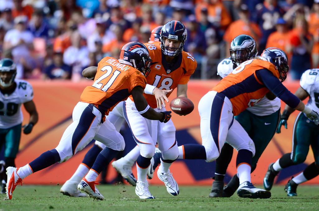 . Denver Broncos quarterback Peyton Manning (18) hands off to Denver Broncos running back Ronnie Hillman (21.) (Photo by AAron Ontiveroz/The Denver Post)