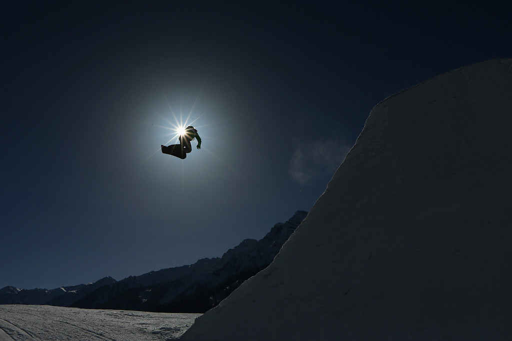 . An athlete trains during Snowboard Slopestyle practice at the Extreme Park at Rosa Khutor Mountain ahead of the Sochi 2014 Winter Olympics on February 4, 2014 in Sochi, Russia  (Photo by Cameron Spencer/Getty Images)