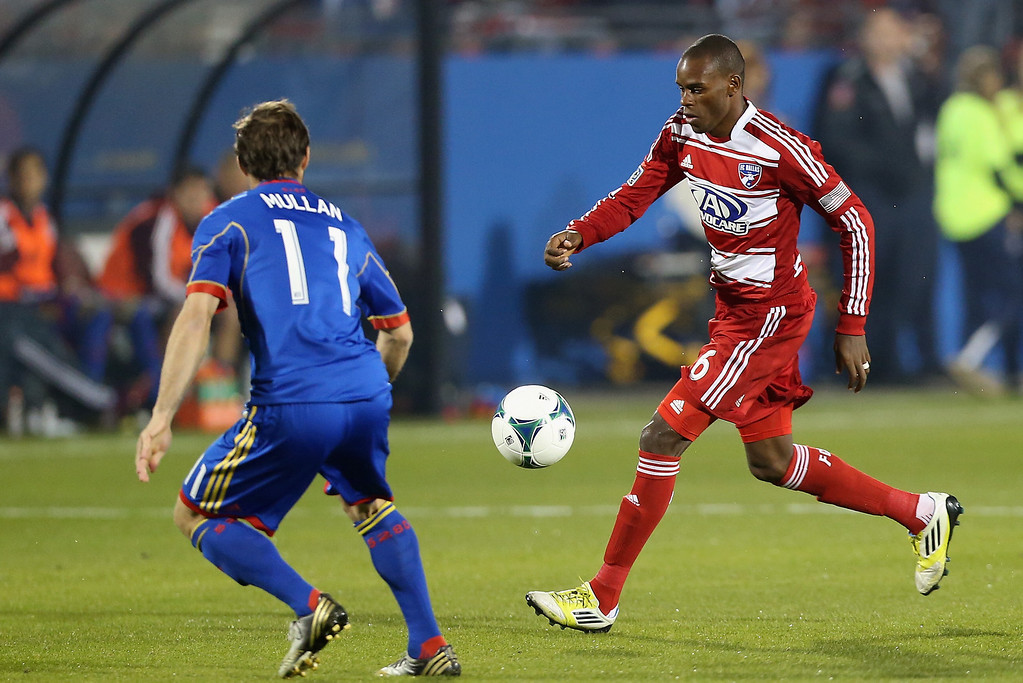 . FRISCO, TX - MARCH 02:  Jackson #6 of FC Dallas dribbles the ball against Brian Mullan #11 of Colorado Rapids at FC Dallas Stadium on March 2, 2013 in Frisco, Texas.  (Photo by Ronald Martinez/Getty Images)