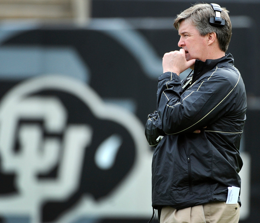 . BOULDER, CO.- APRIL13: New head coach Mike MacIntyre observes his team during play on the field. The University of Colorado football team hosts its spring football game at Folsom Field under the direction of new head coach Mike MacIntyre. (Photo By Kathryn Scott Osler/The Denver Post)