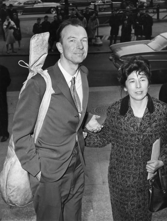 . American folk singer Pete Seeger, a banjo slung over his shoulder, is accompanied by his wife Toshi, on his arrival at the Federal Court, in New York, on April 4, 1961, for sentencing on a conviction of contempt of a Congress charge. He was given a one-year sentence for refusing to answer questions about possible Communist affiliations. Before he was sentenced, Seeger asked Judge Thomas F. Murphy for permission to sing a song. The judge declined. (AP Photo)
