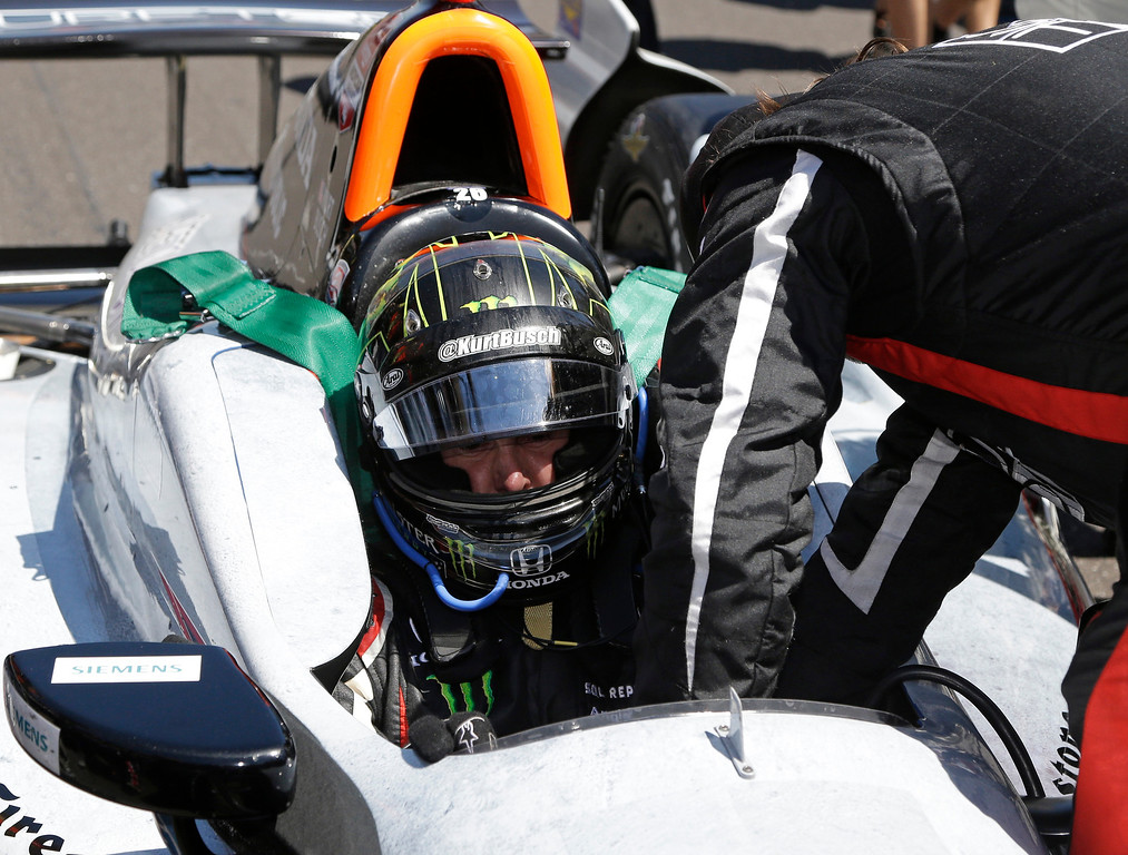 . Kurt Busch is strapped into his car before the start of the 98th running of the Indianapolis 500 IndyCar auto race at the Indianapolis Motor Speedway in Indianapolis, Sunday, May 25, 2014. (AP Photo/R Brent Smith)