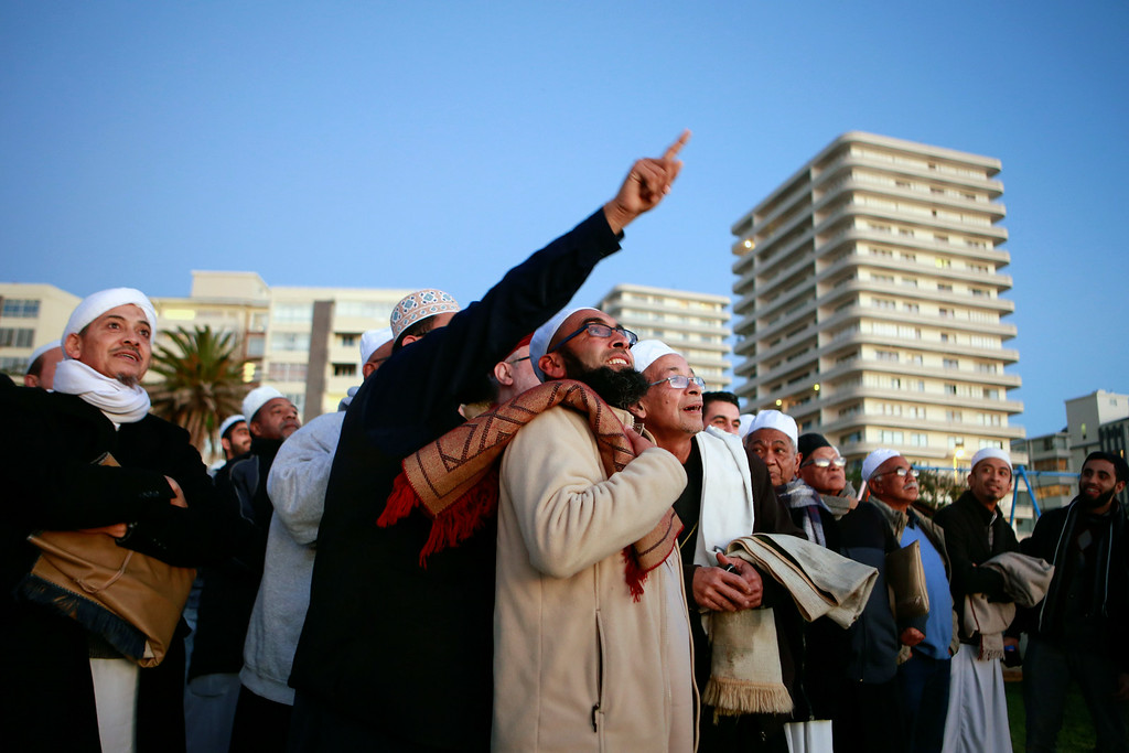 . South African muslims gather on the beach front in Cape Town on June 28, 2014, as they try to spot the new moon, signalling the commencement of the holy month of Ramadan. During Ramadan, Muslim believers abstain from eating, drinking, smoking and having sex from dawn until sunset. Ramadan is sacred to Muslims because it is during that month that tradition says the Koran was revealed to the Prophet Mohammed. The fast is one of the five main religious obligations under Islam. JENNIFER BRUCE/AFP/Getty Images