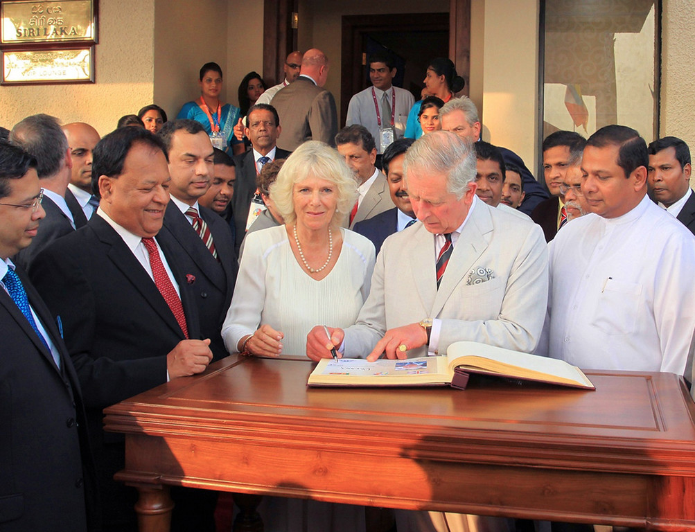 . In this handout photograph received from the Sri Lankan President\'s Office on November 14, 2013, Britain\'s Prince Charles (C) signs a visitors\' book in company of his wife Camilla, the Duchess of Cornwall upon their arrival in Colombo to head the Commonwealth Heads of Government meeting.    AFP PHOTO /SRI LANKAN PRESIDENTS OFFICE/AFP/Getty Images