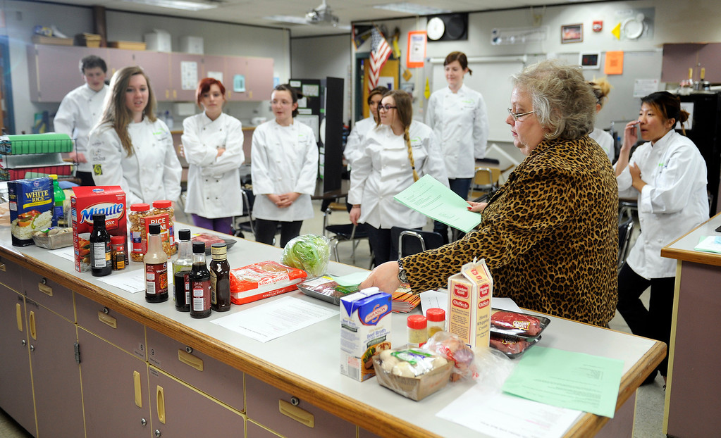 . Many area high schools are developing culinary classes. Standley Lake High School with teacher Valerie Baylie has a class called ProStart sponsored by the Colorado Restaurant Association. Baylie, at right, talks to her class about their ingredients as the class met on Monday, April 22,  2013 to cook 4 beef recipes.   (Photo By Cyrus McCrimmon/The Denver Post)