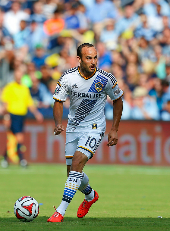 . Los Angeles Galaxy\'s Landon Donovan eyes the goal during the first half against Sporting Kansas City in an MLS soccer game Saturday, July 19, 2014, in Kansas City, Kan. (AP Photo/Topeka Capital-Journal, Chris Neal)