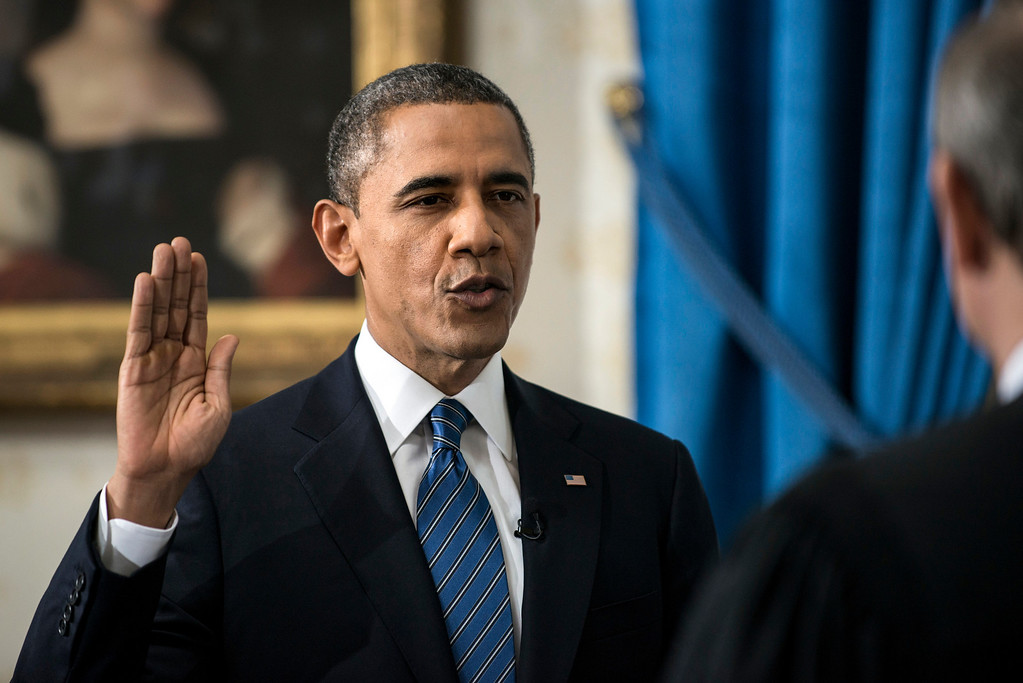 . President Barack Obama is officially sworn-in by Chief Justice John Roberts in the Blue Room of the White House during the 57th Presidential Inauguration in Washington, Sunday, Jan. 20, 2013. (AP Photo/Brendan Smialowski, Pool)