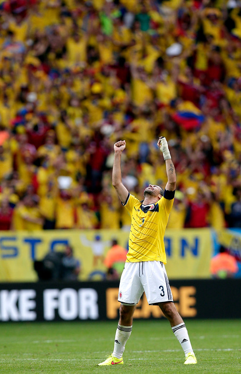. Colombia\'s Mario Yepes celebrates after the group C World Cup soccer match between Colombia and Ivory Coast at the Estadio Nacional in Brasilia, Brazil, Thursday, June 19, 2014.  Colombia won the match 2-1. (AP Photo/Marcio Jose Sanchez)