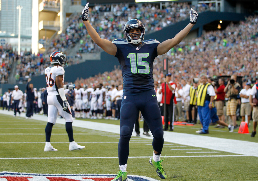 . Seattle Seahawks\' Jermaine Kearse celebrates his touchdown against the Denver Broncos in the first half of a preseason NFL football game, Saturday, Aug. 17, 2013, in Seattle. (AP Photo/John Froschauer)