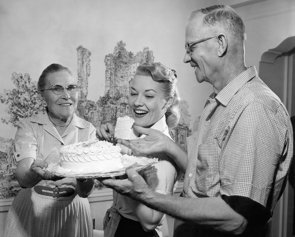 """. Patti Page, blonde and vivacious television and recording star, came home to Oklahoma on June 21, 1957 and was joined immediately by her parents, Mr. and Mrs. B.A. Fowler of Tulsa. Patti got her start on a Tulsa radio station singing as Clara Ann Fowler. She will star in the grandstand production \""""Latin Quarter Revue\"""" as the Semi-Centennial Exposition here for three nights. (AP Photo)"""